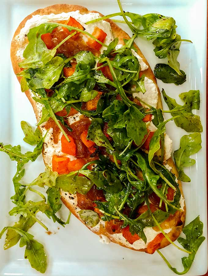Roasted Butternut Squash Flatbread is a picnic pizza that's easy to eat on the go