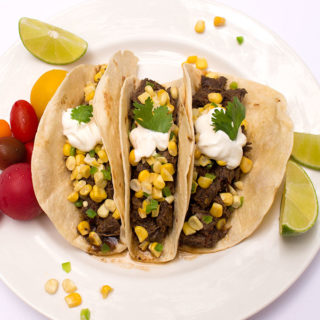 Better than Chipotle beef barbacoa recipe in tacos with corn salsa