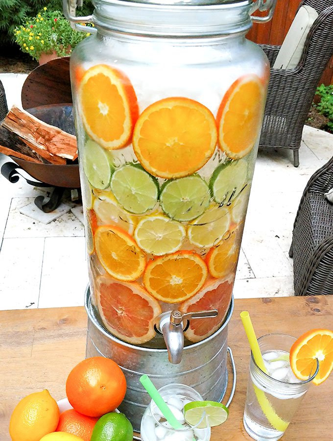 spa water has slices of citrus fruit and can include cucumber for a refreshing summer drink