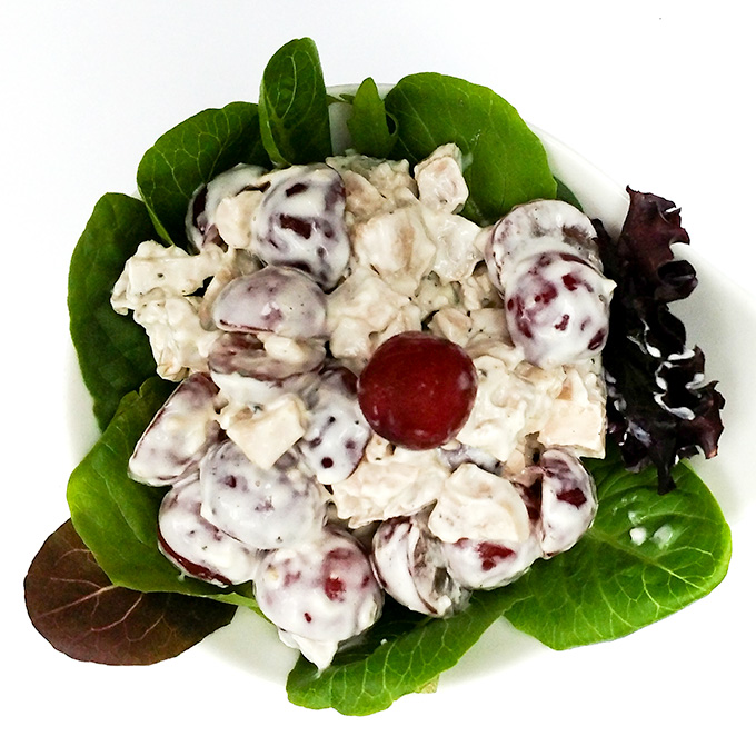 Chicken salad with grapes served over greens